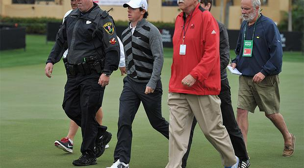 World number one Rory McIlroy walks off the course during the second round of the Honda Classic in Palm Beach Gardens, Florida