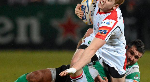 Paddy Jackson, Ulster, is tackled by Robert Barbieri, Benetton Treviso.