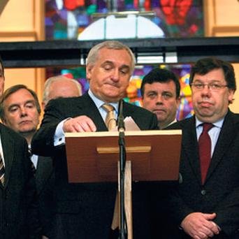 TRANSPARENT SALE: then-Taoiseach Bertie Ahern announces his resignation in front of the stained-glass window of Hone's work at Government Buildings in 2008.