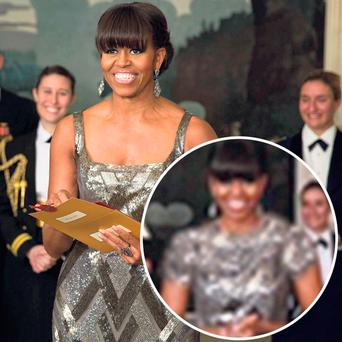 POWER-DRESSING: Michelle Obama's sleeveless dress was given a makeover by Iranian news agency Fars