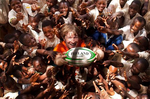 Jerry Flannery gives children at Tamka Primary School their first rugby lesson during his visit to Tanzania