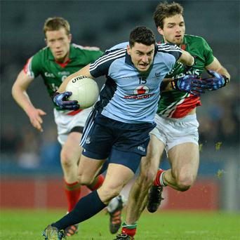 Dublin's Bernard Brogan bursts past Ger Cafferkey