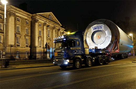 One of the new giant brewing vessels passes Trinity College, Dublin, on its way to St James's Gate brewery