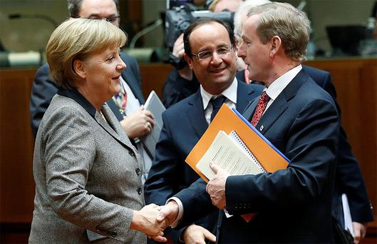 Taoiseach Enda Kenny with his EU counterparts, German Chancellor Angela Merkel and French President Francois Hollande