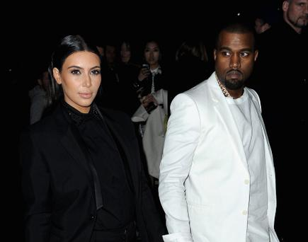 Kim Kardashian and Kanye West attend Givenchy Fall/Winter 2013 Ready-to-Wear show, Paris Fashion Week