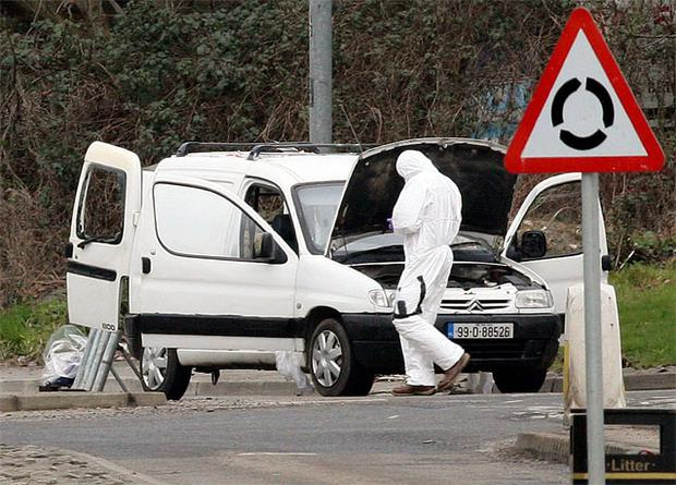 PSNI forensic experts with the van on the outskirts of Derry