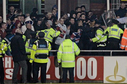 Gardai confront Linfield supporters at Tallaght Stadium.