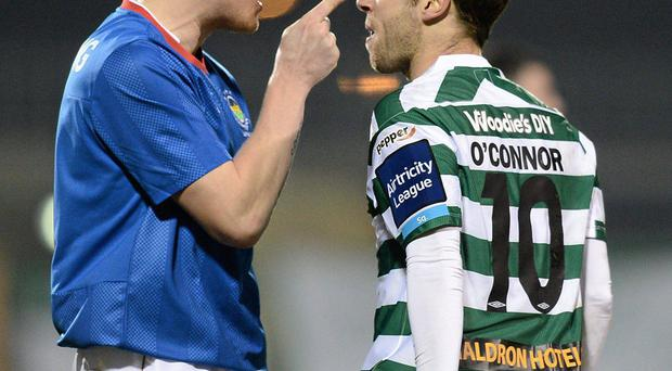 Linfield's David Armstong exchanges words with Sean O'Connor at Tallaght Stadium