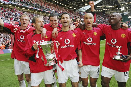 With Darren Fletcher, Phil Neville, John O'Shea, Ruud van Nistelrooy, Mikael Silvestre and Eric Djemba-Djemba, celebrating victory over Millwall in the FA Cup final in May 2004
