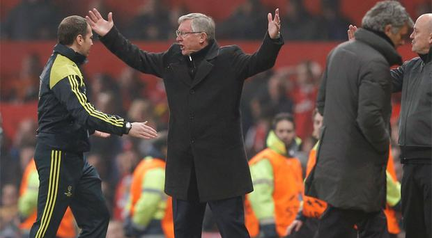 Manchester United manager Alex Ferguson reacts angrily to Nani's red card