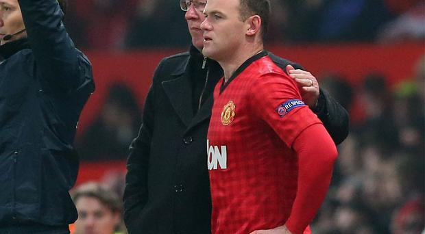 Wayne Rooney prepares to come on as a substitute against Real Madrid