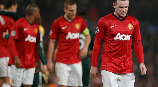 Manchester United's Wayne Rooney reacts after the Champions League exit