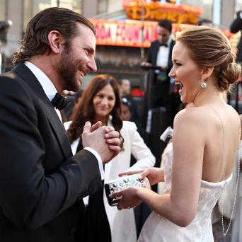 Bradley Cooper and Jennifer Lawrence at the Oscars.