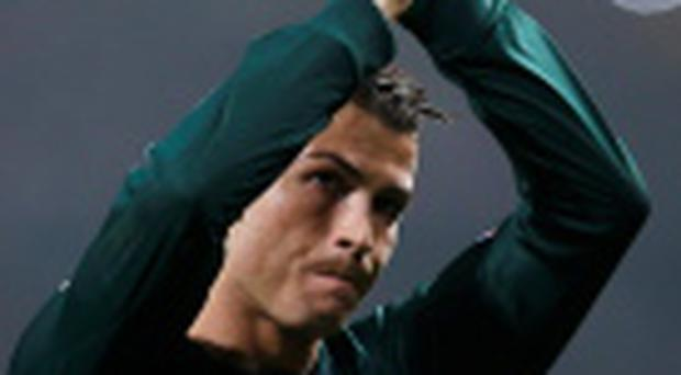 Real Madrid's Cristiano Ronaldo reacts after the game