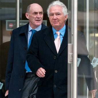 Former Anglo boss Sean FitzPatrick and solicitor Michael Staines, left, leave the court after the hearing