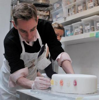 Ryan Tubridy putting the finishing touches to the cake at Bake My Cake in Blackrock, Co Dublin