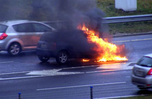 A car on fire near Leopardstown interchange on M50 during morning rush hour