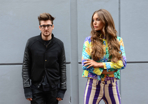Henry Holland and model Roz Purcell. Roz is wearing stripe jeans €175, pom-pom print blouse €250 and pom-pom print blazer €435.