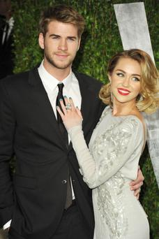 Liam Hemsworth and Miley Cyrus, pictured at the Oscars last year, are being plagued by break-up rumours. (Photo by John Shearer/WireImage)