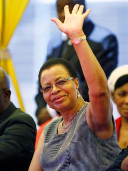 Graca Machel, the Mozambican wife of former president Nelson Mandela, waves during the memorial service of 27-year-old taxi driver Mido Macia in Daveyton, east of Johannesburg March 6, 2013.