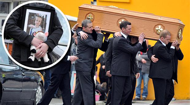 The funeral in Schull of Martin Mc Carthy and daughter Clarrisa. Inset: A mourner carries a picture of 3-year-old Clarrisa McCarthy