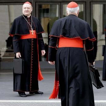 Cardinals arrive at the Vatican as they prepare to elect a successor to Pope Benedict
