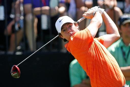 Rory McIlroy is delighted for the cover Woods' recent ascent provides