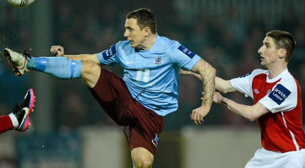 Gary O'Neill, Drogheda United, in action against Ian Bermingham, St. Patricks Athletic.