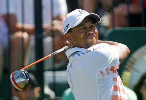 Tiger Woods tees off on the first hole during second round play