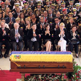 Officials attend the funeral ceremony for Hugo Chavez at the military academy in Caracas, Venezuela.