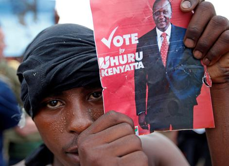A supporter of presidential candidate Uhuru Kenyatta celebrates on the outskirts of Nairobi