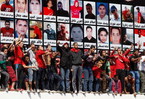 Al-Ahly fans shouts slogans in front of the Al-Ahly club after hearing the final verdict of the 2012 Port Said massacre