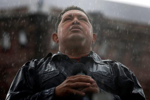 Hugo Chavez speaks in the rain during his closing campaign rally last October