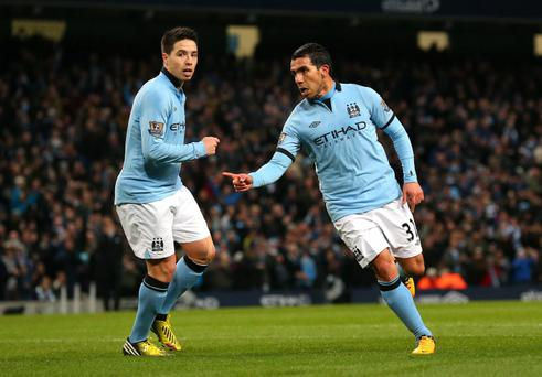 Carlos Tevez of Manchester City celebrates after scoring the third goal at the Etihad