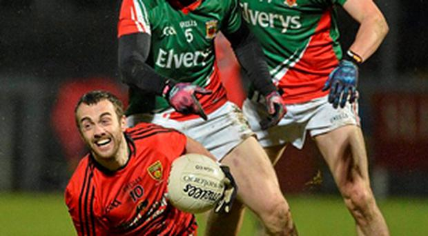 Conor Laverty, Down, in action against Lee Keegan, centre, and Jason Doherty, right, Mayo.