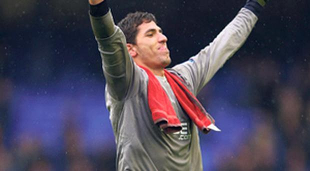 Joel Robles of Wigan Athletic celebrates his side's win