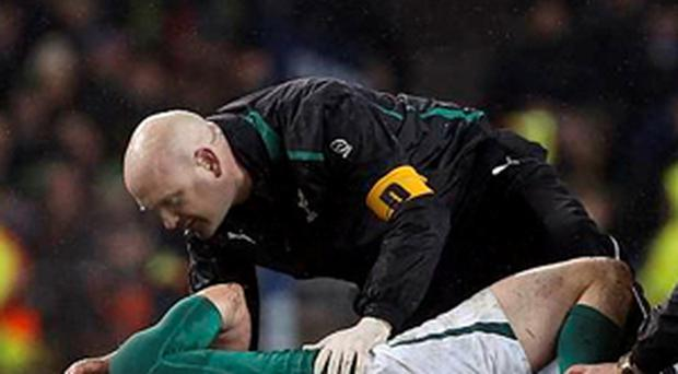 Eoin Reddan is given medical attention during the Six Nations match at Aviva Stadium