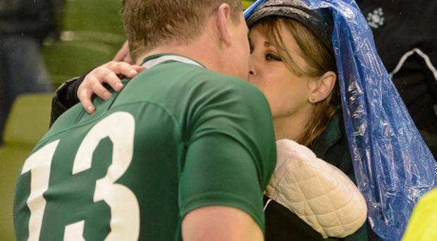 Brian O'Driscoll is greeted by his wife Amy and daughter Sadie after the game. Photo: Diarmuid Greene/Sportsfile