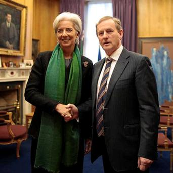Enda Kenny greets Christine Lagarde, Managing Director of the International Monetary Fund, ahead of a meeting at Government Buildings