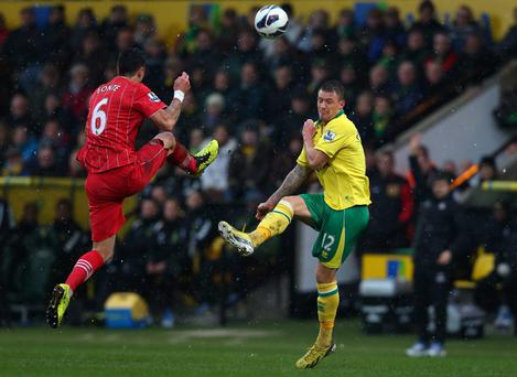 Anthony Pilkington gets the ball away from Jose Fonte of Southampton
