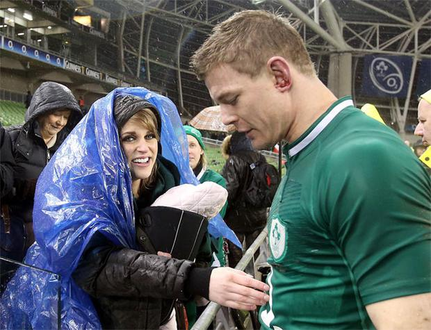 Brian O'Driscoll is greeted by wife Amy and daughter Sadie after leaving the pitch with an injury.