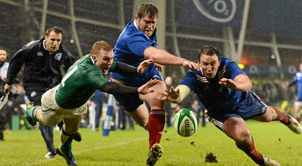Ireland's Keith Earls is blocked by France's Vincent Debaty (left) as Louis Picamoles touches down for a France '22' in the latter stages of Saturday's draw