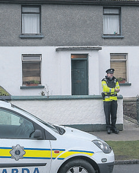 A garda outside the house in Kilkenny city where the dead man was found.