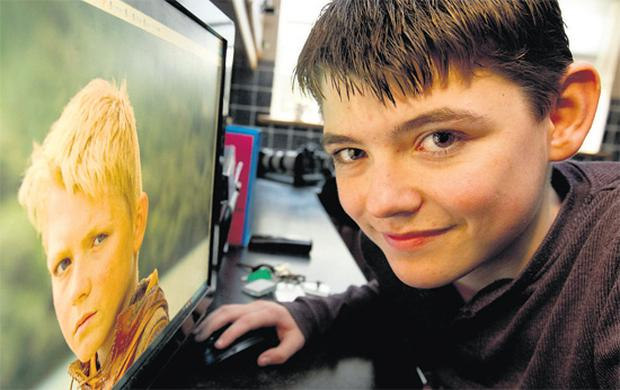 Nathan O'Toole, right, watches himself on the History Channel's ratings winner 'Vikings', which also stars Gabriel Byrne. MARK CONDREN