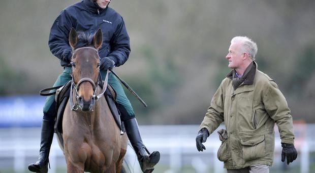 Trainer Willie Mullins' with Ruby Walsh riding Quevega on the gallops at Cheltenham