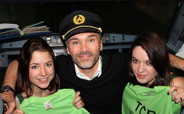 TCD students Rosie Goulding and Nicole O'Sullivan (right) with a pilot during thier TCD Jailbreak adventure