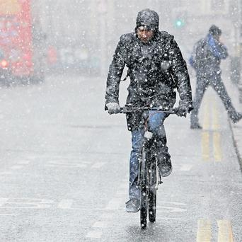 Snow showers make life difficult for cyclists on Dame Street, Dublin, as temperatures continued to drop nationwide