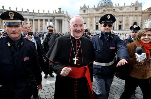 Popular papal candidate Canadian Cardinal Marc Ouellet makes his way across St Peter's Square