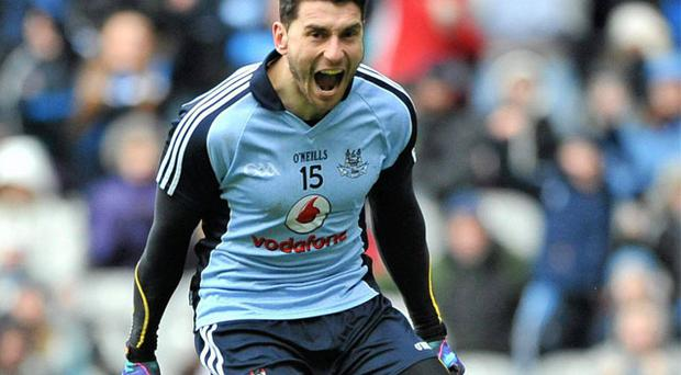 Dublin's Bernard Brogan celebrates after scoring his side's second goal past Kildare goalkeeper Shane Connolly