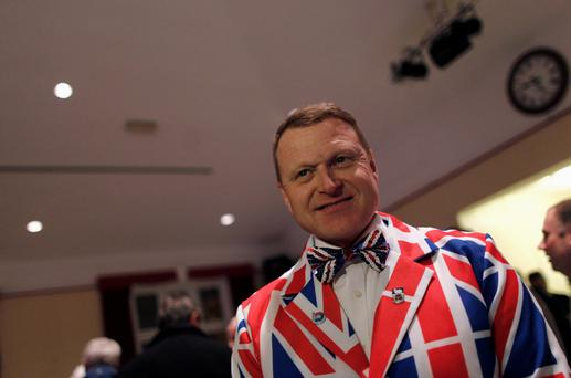 Andrew Brown Lee, a Falklands islander, wears a suit with the Union Jack colours as he attends the vote counting at the Town Hall in Stanley March 11, 2013. Residents of the Falkland Islands voted on Sunday and Monday in a sovereignty referendum that seeks to counter Argentina's increasingly assertive claim over the British-ruled territory. REUTERS/Marcos Brindicci (FALKLAND ISLANDS - Tags: POLITICS ELECTIONS)